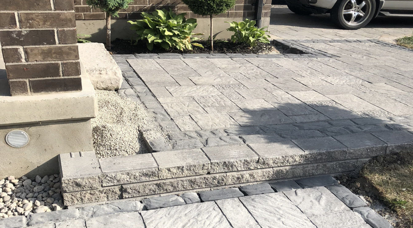 Paver Front Entry, Steps and Walkway with Borders in London Ontario region, a project by O'Connor Stone & Landscape, a landscae and hardscape contractor.