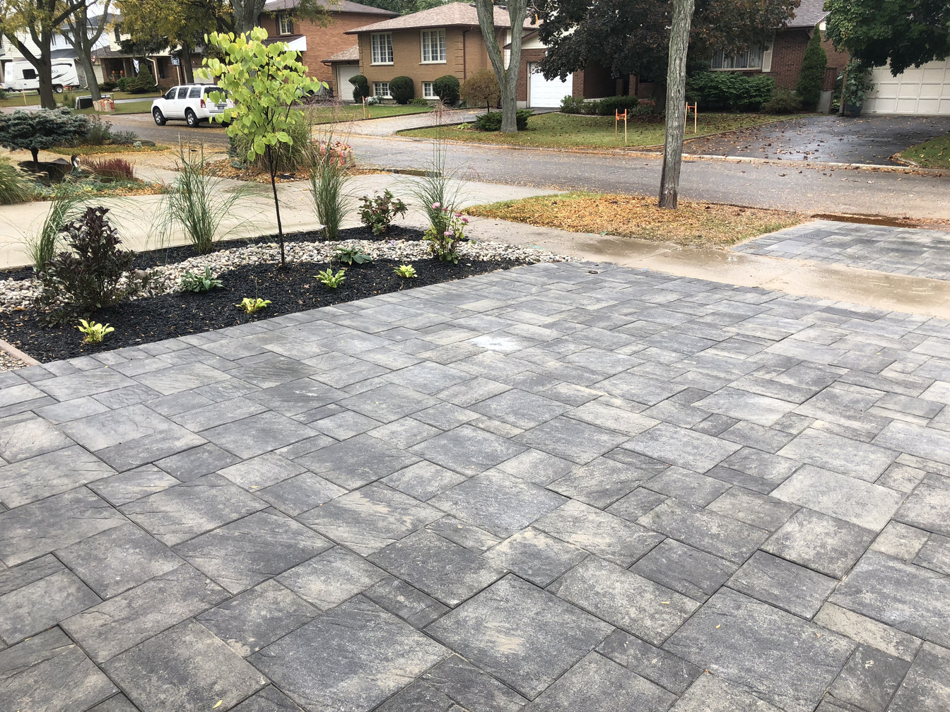 Interlocking Brick Paver Driveway in London Ontario region, a landscape & hardscape project by O'Connor Stone & Landscape, a local contractor.