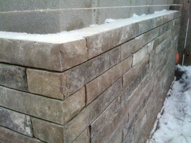 Natural stone wall cladding, a stone masonry project in London Ontario region by O'Connor Stone & Landscape, local contactor.