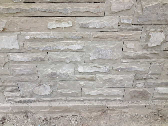 Natural stone wall cladding, a stone masonry or masonry project in London Ontario region by O'Connor Stone & Landscape, your landscape & hardscape contactor.